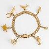 18k gold bracelet, with charms.