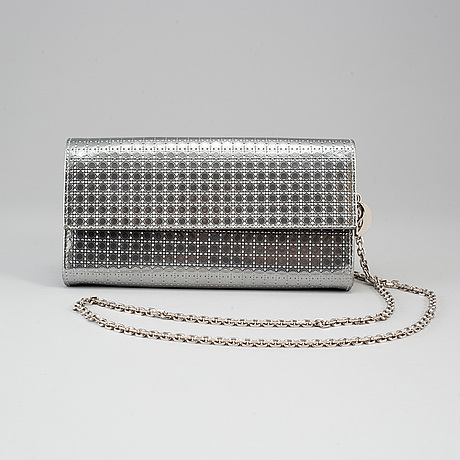 Christian dior, an embossed metallic leather 'wallet on chain' clutch.