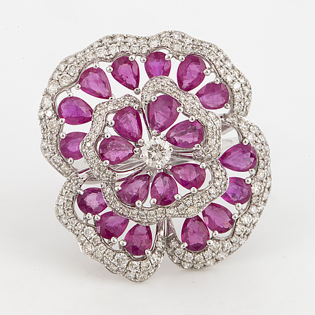 Ruby and brilliant-cut diamond flower ring.