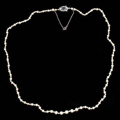 Pearl necklace, clasp 18k white gold, wa bolin  stockholm 1964, with cabochon-cut sapphire and brilliant-cut diamonds.