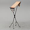 A wrought iron stand, first half of the 20th century.