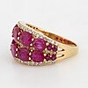 Oval shaped ruby and brilliant-cut diamond ring.
