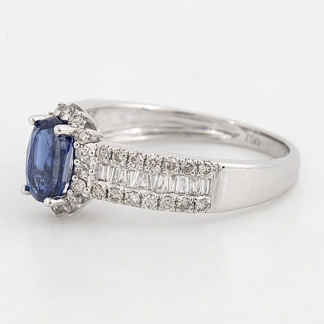 Kyanite and brilliant-cut diamond ring.