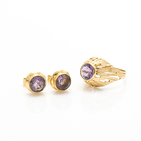 A set of 14k gold earrings and a ring with amethysts.