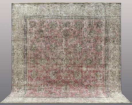 An oriental carpet, ca 315 x 287 cm.