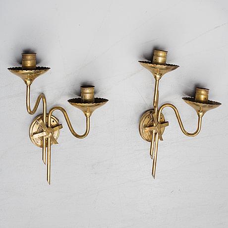 A pair of swedish modern brass wall lights, 1930-40s.