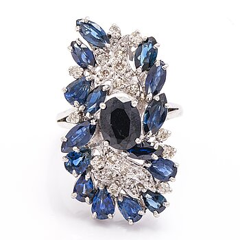 A 12K white gold ring with diamonds ca. 0.30 ct in total and sapphires. 1970's.