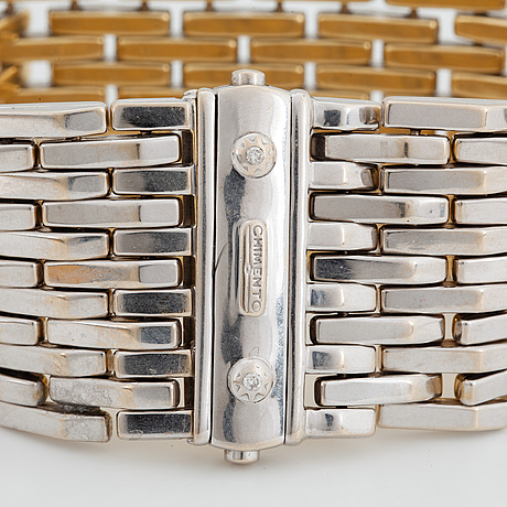 18k gold and white gold bracelet, with box.