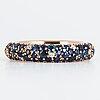 An enamel and brilliant cut diamond ring.