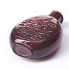 A red glass snuff bottle with stopper, qing dynasty, 19th century.