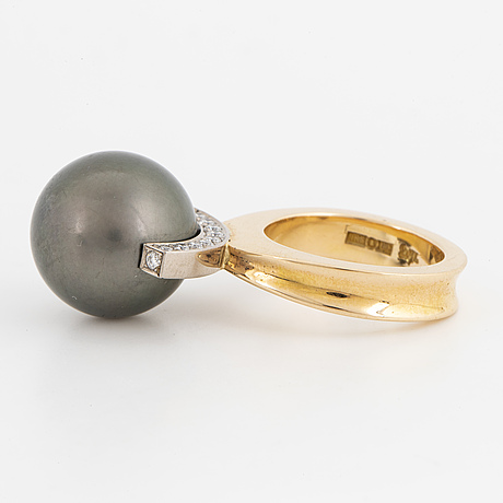 Cultured tahiti pearl and brilliant-cut diamond ring by rolf karlsson.