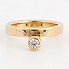 18k gold an cubic zirkona ring by rolf karlsson.