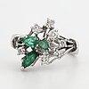 White god, brilliant-cut diamond and emerald ring.
