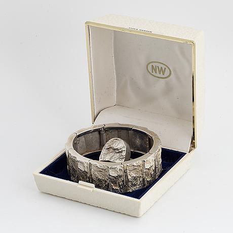 A silver bracelet and ring finlandia koru.