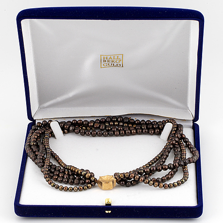 A five strand cultured pearl necklace.