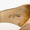 An 18k gold stigbert ring.