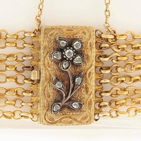 An 18k gold bracelet set with rose-cut diamonds.