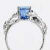 Oval faceted sapphire and brilliant-cut diamond.