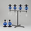 Erik höglund, a wrought iron and glass candelabrum and pair of candelsticks from boda smide.