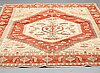 A carpet, heriz design 292 x 238 cm.