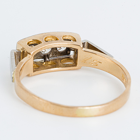 18k gold and brilliant-cut diamond three-stone ring.
