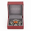 A georg jensen brooch 173 silver set with amber.
