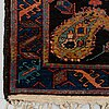 A rug, an old kurdish probably, ca 140,5-143,5 x 94,5-102 cm (as well as 2 cm flat weave at each end).