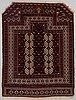 A rug, semi-antique, namazlyk, turkmen, circa 115 x 91 cm.
