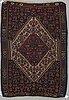 A rug, a kilim, senneh, ca 148,5-156,5 x 99-106 cm.