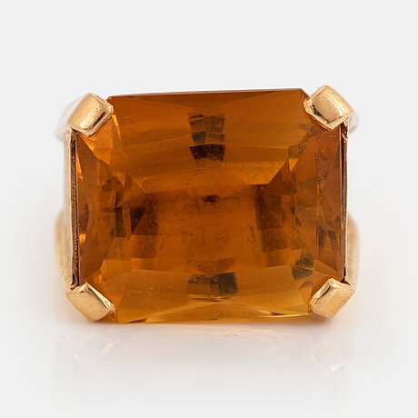 An 18k gold ring set with a faceted citrine.