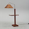A mid-20th-century combined floor lamp and side table.