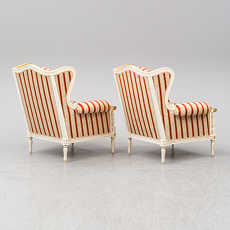 A pair of louis xvi-style armchairs from the second half of the 20th century.