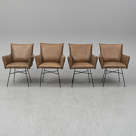 Four leather chairs from jess design.