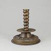 A 17th century brass candlestick.