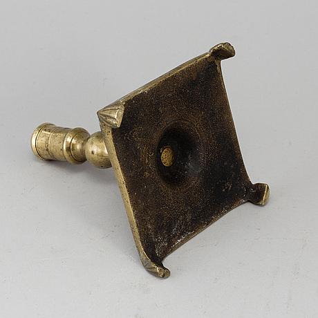 A 17th century bronze candlestick.
