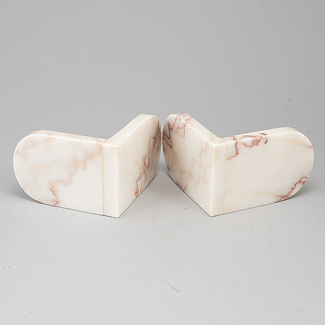 A pair of marble book ends, 20th century.