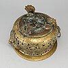 An 18th century brass flower pot.