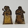 A pair of 19th century brass spoon holders.
