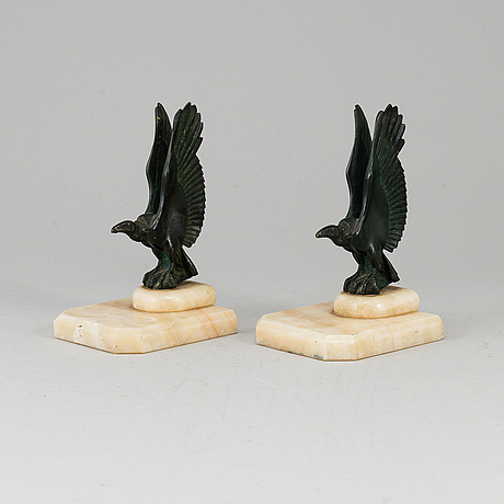A pair of art déco marble and bronze book ends, 1930s.