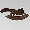 A 19th century iron meat cutter.