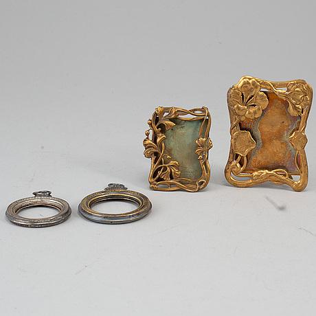 Four silver och metal miniature frames, ca 1900.
