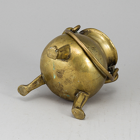A 17th century brass bowl.