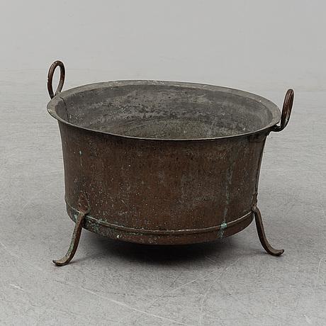 A 19th century copper cauldron.