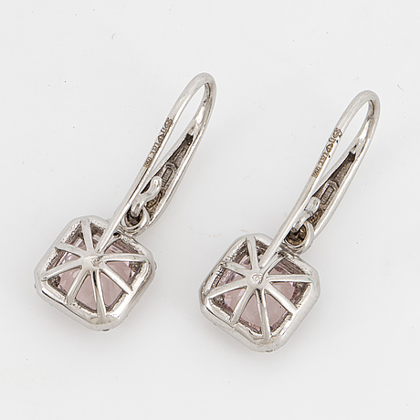 A pair of fasette-cut morganites and brilliant-cut diamond earrings.