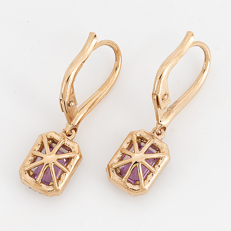 A pair of pink sapphire and brilliant-cut diamond earrings.