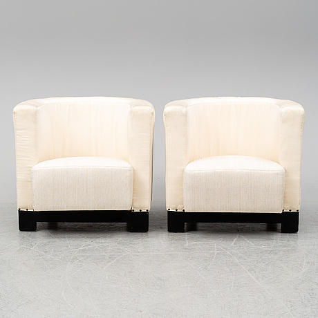 A pair of italian easy chairs, late 20th century.