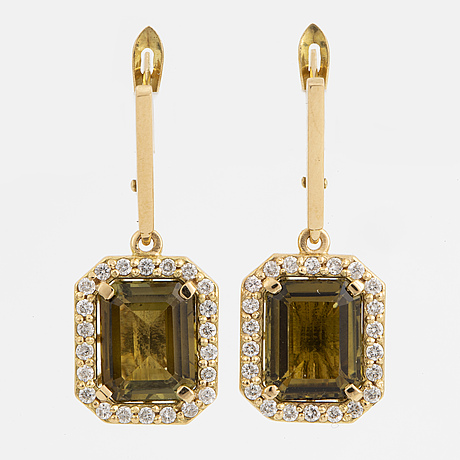 A pair of faceted olive green tourmaline and brilliant-cut diamond earrings.