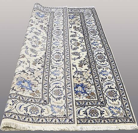 A carpet, nain part silk 287 x 192 cm.