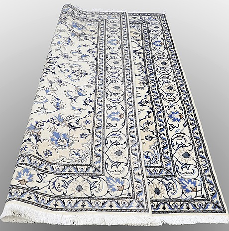A rug nain part silk, ca 243 x 166 cm.