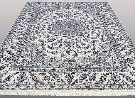 A carpet, nain part silk, ca 350 x 250 cm.